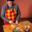 Stock Photo: Woman preparing salad