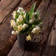 Fading snowdrops in vase - Stock Photo