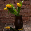 Beautiful yellow tulips in  vase — Stock Photo