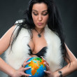 Beautiful woman holding a globe — Stock Photo