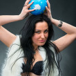 Beautiful woman holding a globe — Stock Photo #22406979