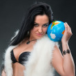 Beautiful woman holding a globe — Stok fotoğraf