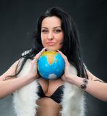Beautiful woman holding a globe — Stock Photo