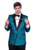 Young magician with string — Stock Photo
