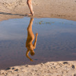 Reflection of young naked woman — Stock Photo