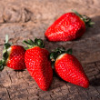 Strawberries over Wooden Background - Stock Photo