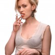 Emotional sexy woman posing with cigarette — Stock Photo
