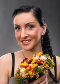Young woman with beautiful hairstyle and dry bouquet — Stock Photo