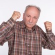 Mature man in boxer pose with raised fists — Stock Photo