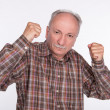 Mature man in boxer pose with raised fists — Stock Photo #25756995