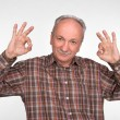 Elderly man shows ok sigh — Stock Photo