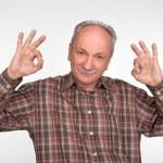 Elderly man shows ok sigh — Stock Photo