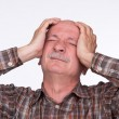 Old man suffering from a headache — Stock Photo #25757035