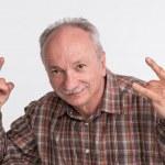 Portrait of an elderly man gesturing — Stock Photo #25757079