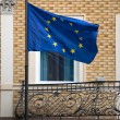 Balcony of the old  building with the flag the European Union — Stock Photo