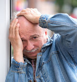 Old man suffering from a headache — Stock Photo