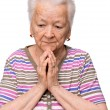 Old woman praying — Stock Photo #26198029