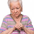 Old woman praying — Stock Photo #26198065