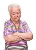 Portrait of old woman with crossed hands — Stock Photo