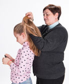 Grandmother combing hair her granddaughter — Stock Photo