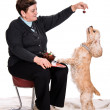 Senior woman feeding spaniel — Stock Photo