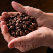 Stock Photo: Old woman hands holding coffee beans