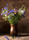 Beautiful bouquet of bright wildflowers in vase — Stock Photo