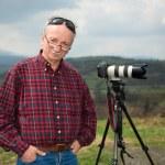 Senior photographer with camera — Stock Photo #26734057