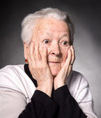 Portrait of surprised old woman — Stock Photo