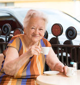 Senior woman having a cup of coffee — Stock Photo