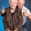 A grown son showing ok with his aging mom — Stock Photo
