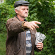 The farmer with a pack of money — Stock Photo