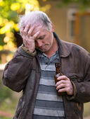 Drunk man with bottle of beer — Stock Photo