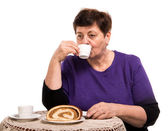 Mature woman having coffee with cake — Stock Photo