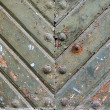 Ancient weathered door background texture with metal rivets — Stock Photo