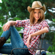 Young cowgirl in hat — Stock Photo