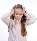 Little girl suffering from headache — Stock Photo