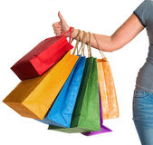 Female hand holding shopping bags and showing ok — Stock Photo