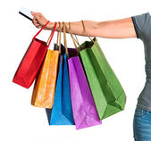 Woman's hand holding shopping bags — Stock Photo