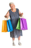 Happy old woman with shopping bags — Stock Photo