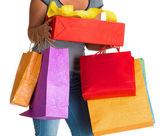Woman holding shopping bags and gift box — Stock Photo