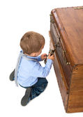 Little boy picking up the key to the lock — Stock Photo