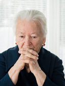 Senior woman praying — Stock Photo