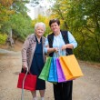 Two women with shopping bags in the street — Stock Photo