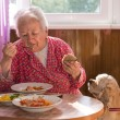 Eating old woman — Stock Photo #32611803