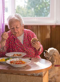 Eating old woman — Stock Photo