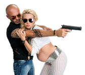 Man with a gun and pregnant woman — Stock Photo