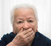 Old woman yawning — Stock Photo
