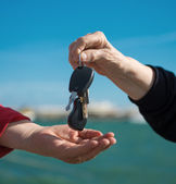 Hands and a car key — Stock Photo
