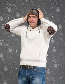 Surprised handsome man in winter hat — Stock Photo